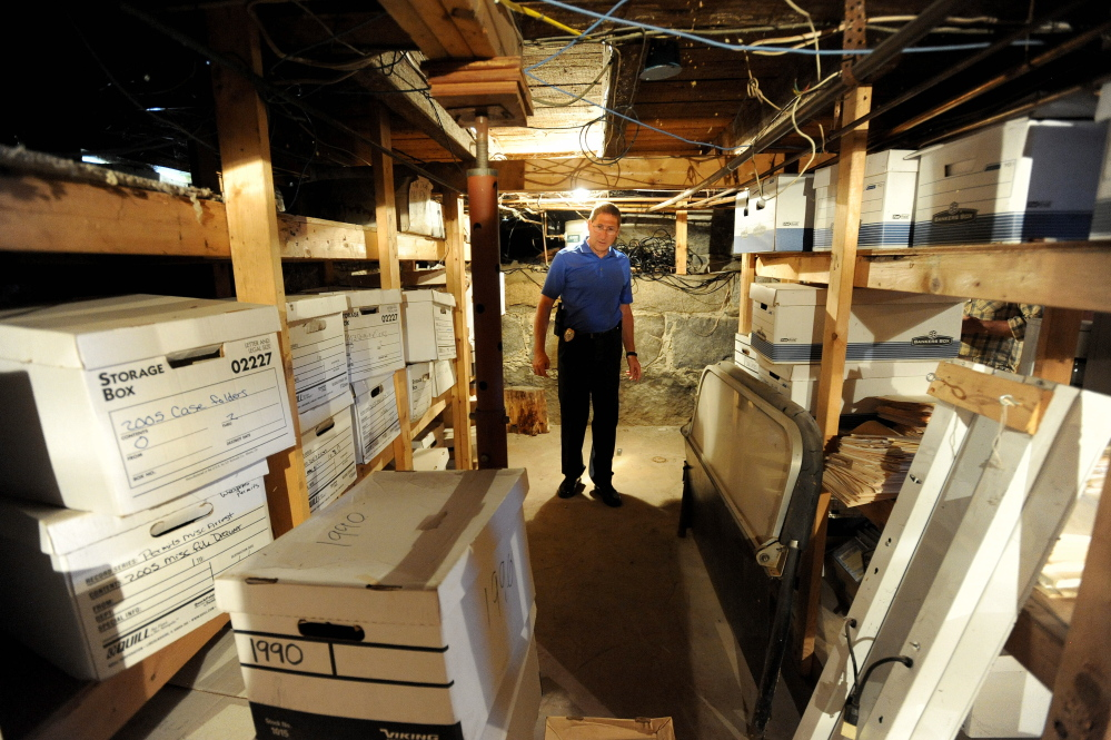 Michael Tracy, Oakland's police chief, stands on July 9 in the basement of the police station, where documents are stored. Inadequate storage is one reason the town is proposing to replace the station with a $1.05 million building.