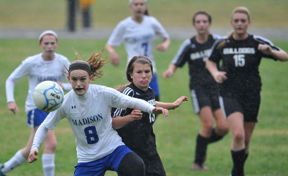 Staff file photo by Michael G. Seamans   Madison's Kayla Bess, front, fights for the ball with Hall-Dale defender Emma Begin during a Mountain Valley Conference game last fall. Bess will lead a formidable Bulldogs squad this season.