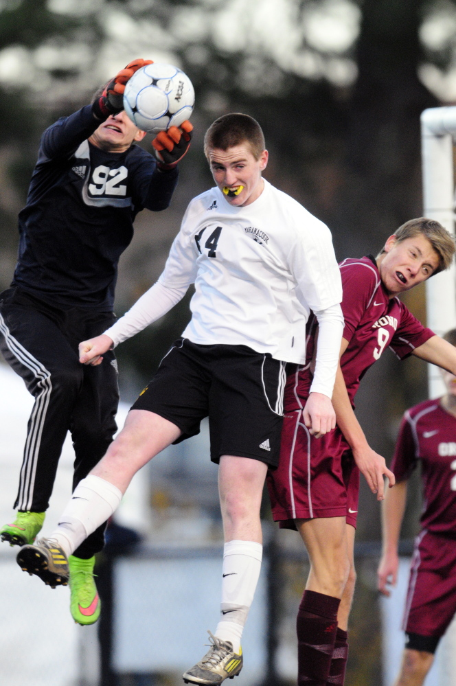 Staff file photo by Joe Phelan   Orono keeper Alik Espling, left, makes a save in front of Maranacook's Jason Brooks, center, while Orono's Mazime Neitschke defends during the Class C state championship game last fall.
