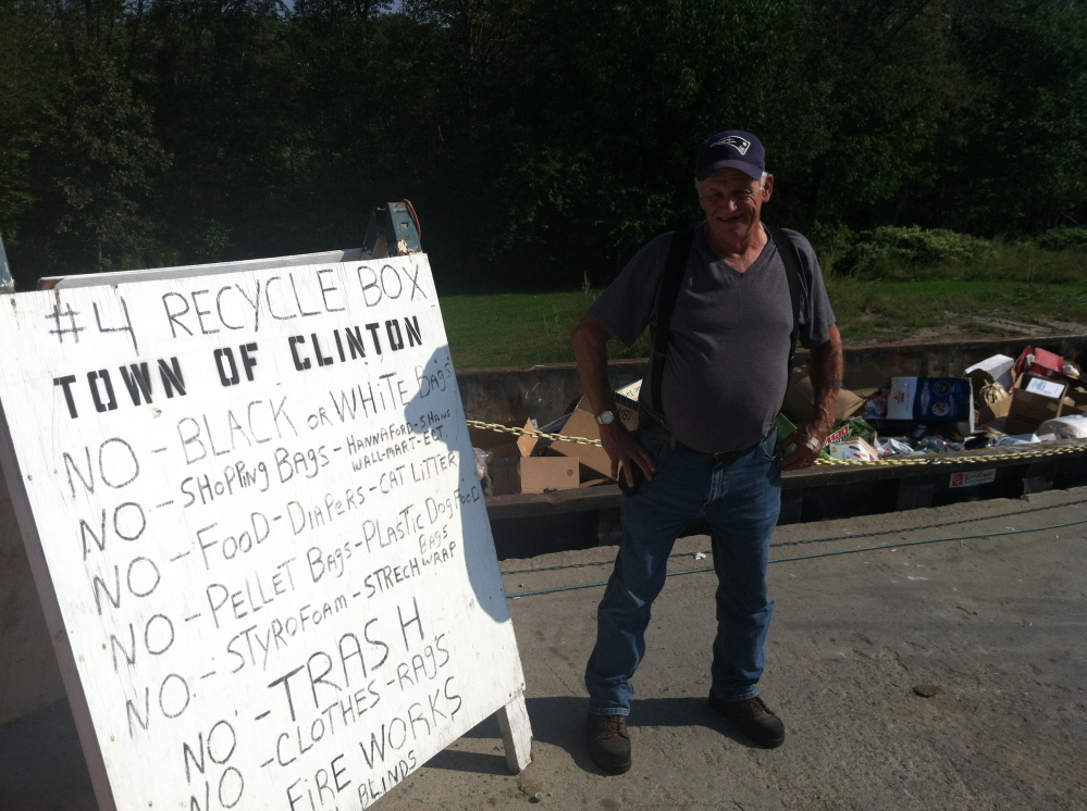 Clinton-Benton Transfer Station Director Gerald Howard stands near a sign informing residents of the station's  single-sort recycling rules Wednesday.