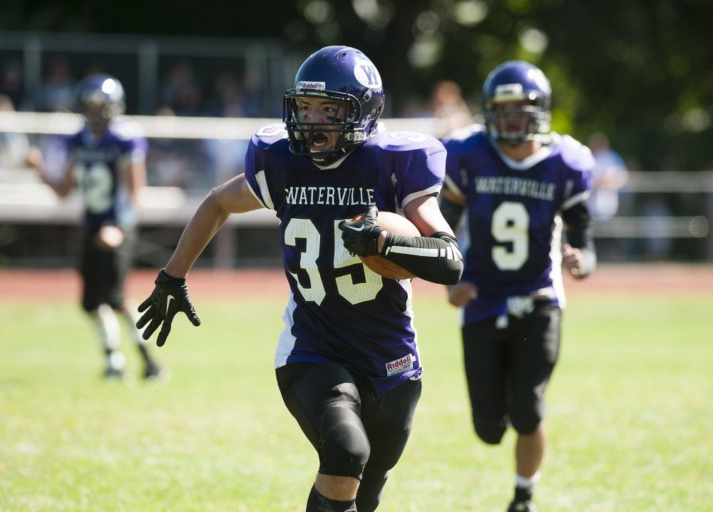 Kevin Bennett photo   Waterville's Devon Begin sprints toward the end zone during the first quarter of a game against Hermon on Saturday in Waterville.
