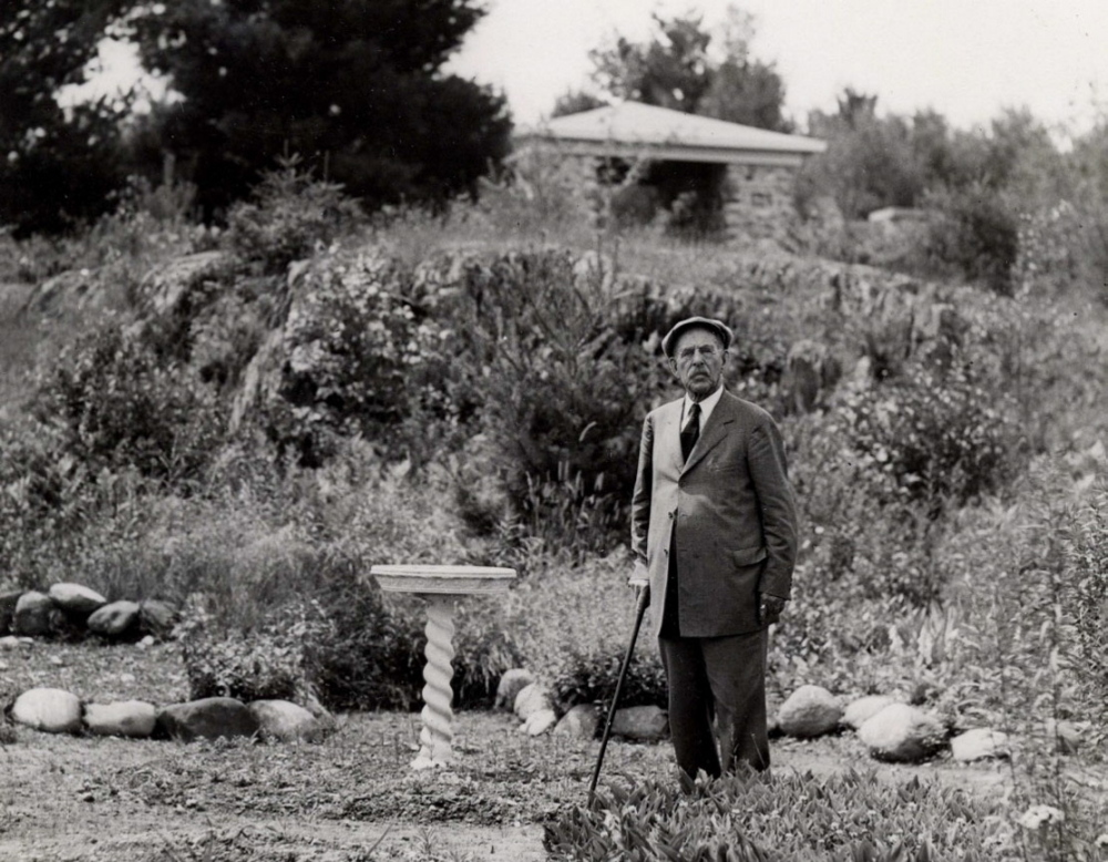L.C. Bates Museum contributed photo George W. Hinckley, founder of Good Will-Hinckley, poses next to the bird sanctuary and gardens that are part of the trail system at the L.C. Bates Museum on the Good Will-Hinckley campus on U.S. Route 201. To celebrate the 100th anniversary of the Dartmouth Trail, museum officials are hoping at least 100 hikers walk the trails Saturday.