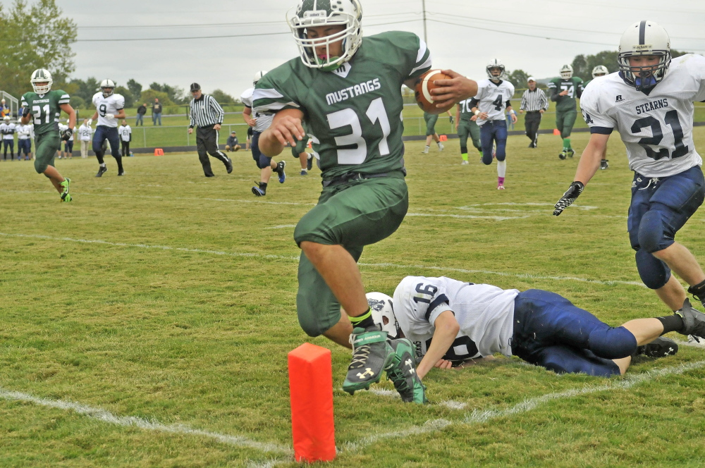 Staff file photo by Michael G. Seamans   Mount View running back Tyler Ripley scores a touchdown duringa game against Stearns last Sept. 20 in Thorndike. Ripley and the Mustangs will have their hands full when front-running MCI comes to town.