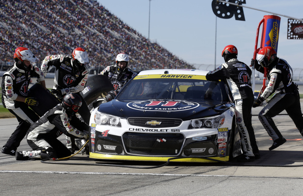 Kevin Harvick (4) makes a pit stop during the NASCAR Sprint Cup Series race Sunday at Chicagoland Speedway in Joliet, Ill.