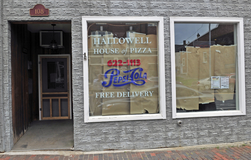 Seating at the Hallowell House of Pizza was damaged and the wall was spray-painted inside the restaurant earlier this month. The restaurant remains closed on Tuesday nearly two weeks after someone broke in and damaged the building before stealing money.
