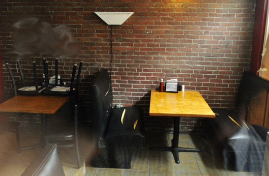 Seating at the Hallowell House of Pizza was damaged and the wall was spray painted inside the restaurant earlier this month. The Kennebec Journal blurred the writing on the wall because of its offensive nature.