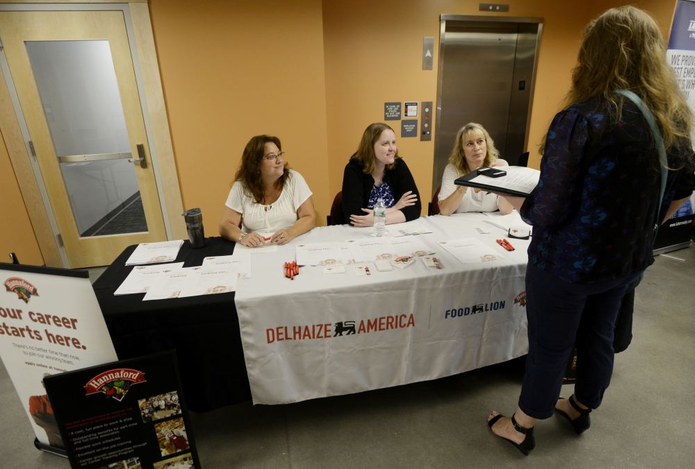 Holly Norburg of Old Orchard Beach, standing, meets with Hannaford associate relations managers, from left, Karen Badger, Lisa Lombard and Melissa Cyr during a job fair Wednesday at the Greater Portland CareerCenter.