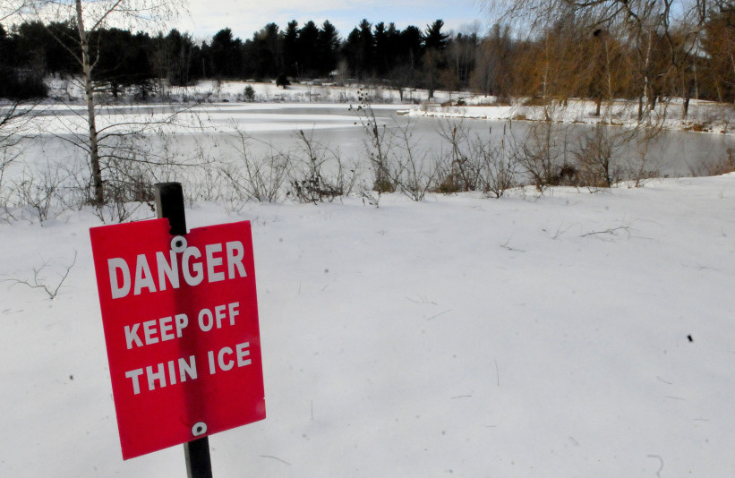 A sign warns skaters to stay off the thin ice at Johnson Pond on the Colby College campus in Waterville on Monday.