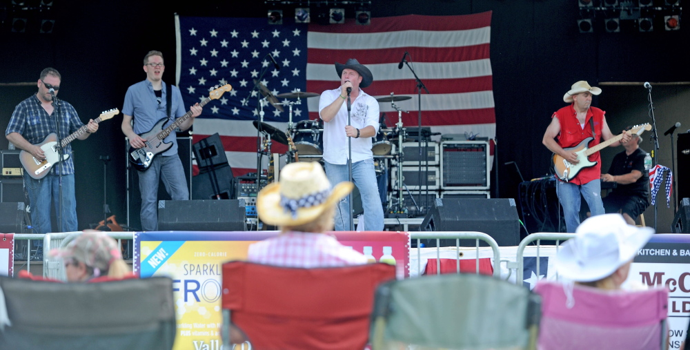 Bad Penny performs in 2014 at Fort Halifax Park in Winslow as part of the Winslow Family 4th Celebration. Organizers of the event, which draws tens of thousands every year, say a higher bill from the Police Department may make it impossible to continue holding the event.