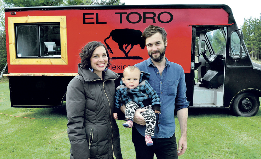Anne Holloway and Garnet Keim and their son Aero, of Weld, pose outside their food truck, which will debut this summer in Franklin County. They also have a son Jude, 3.