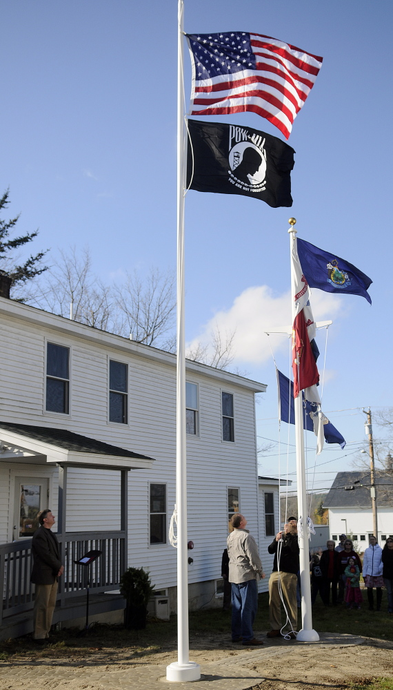 Flags fly above the Bread of Life Ministries Veterans Shelter in Augusta. A Bangor man says he suffered injuries in 2012 during an arrest at the shelter, but a federal court jury ruled against him Thursday in Bangor in a civil lawsuit.