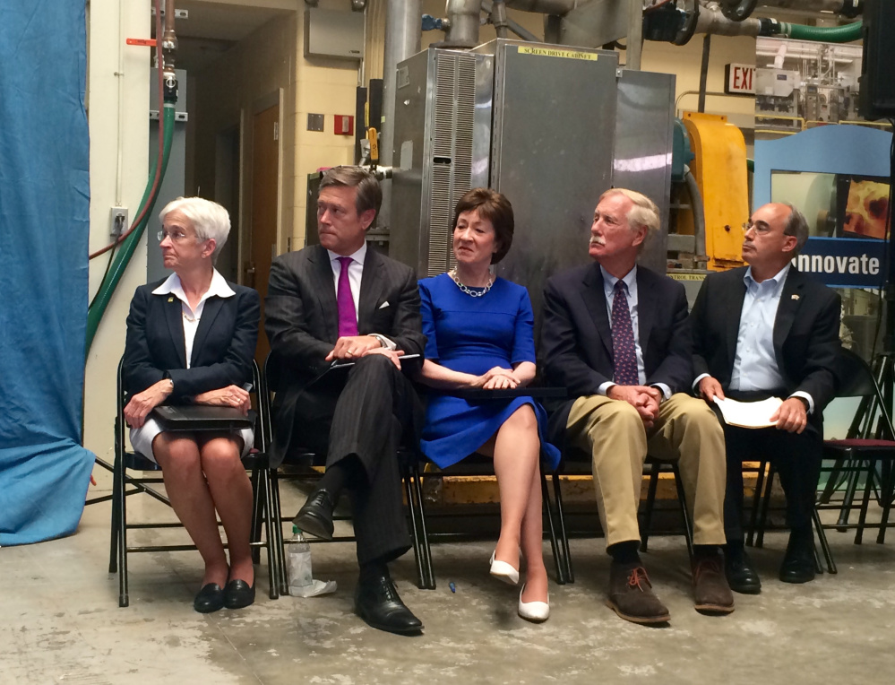 From left, University of Maine President Susan Hunter; Matt Erskine, U.S. deputy assistant director of commerce for economic development; U.S. Sen. Susan Collins; U.S. Sen. Angus King; and U.S. Rep. Bruce Poliquin listen to remarks at a news conference Friday announcing plans for the federal government to invest in and assess the state's forest products industry.