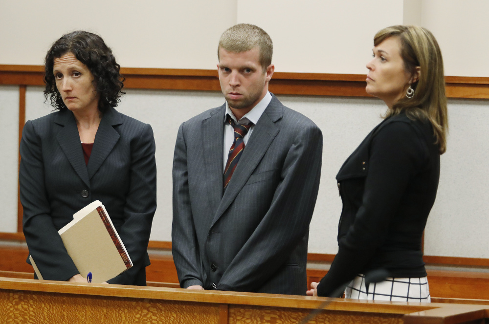 Kenneth Briggs Jr. – joined by attorneys Molly Butler Bailey, left, and Heather Gonzales – appears in court for a hearing Monday at the Cumberland County Courthouse in Portland.