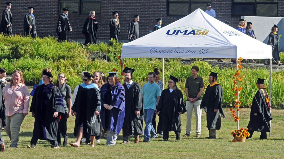 Faculty and rising scholars process in at the start of University of Maine at Augusta's Convocation on Friday on campus in Augusta.