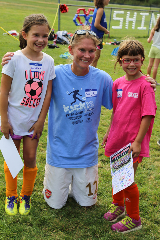 Penny Stansfield, Messalonskee High School girls' soccer coach, center, with two of her youngest fans, Annabell and Reese Hanscomb, who attended Shine On Saturday youth mentoring day at the Oakland high school.