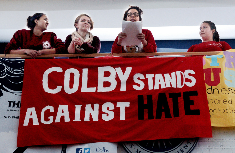 In this 2016 file photo, Colby College students address 300 students and staff who assembled in Cotter Union before marching on campus in Waterville in a protest against hate and against immigration policies proposed by then-President-elect Donald Trump.