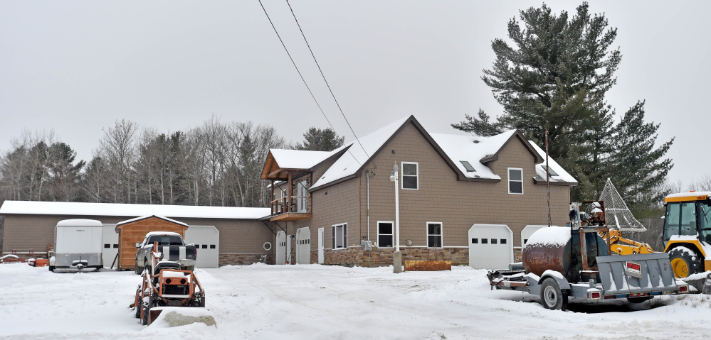 The home at 160 Drummond Ave. in Waterville is seen Dec. 29, 2015, three days after the body of Stacey MacDonald was found outside the building. MacDonald accidentally fell from the second story of the home because a balcony hadn't been built outside a sliding glass door.