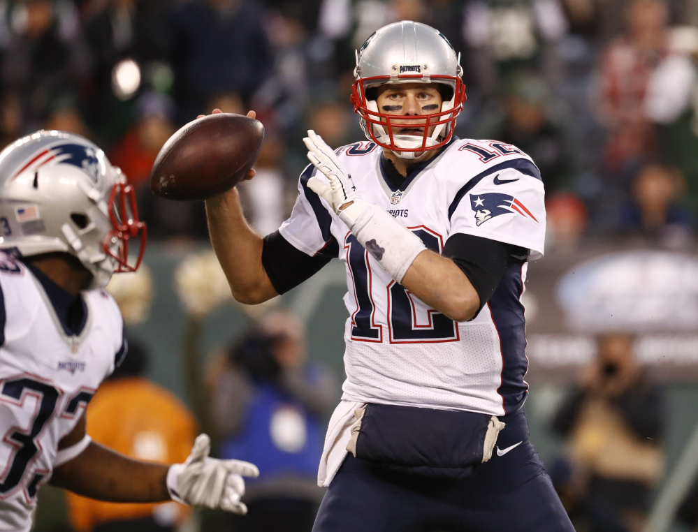 New England Patriots quarterback Tom Brady (12) looks to pass to running back Dion Lewis (33) during the first quarter of game game last month in East Rutherford, New Jersey. New England (10-2) hosts the Baltimore Ravens tonight.