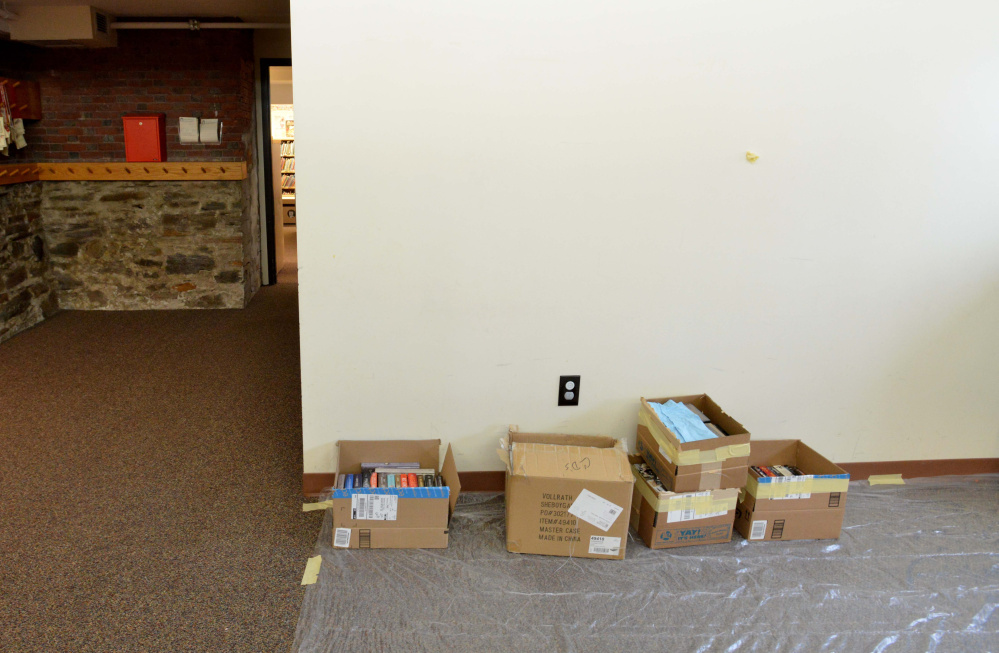 A drying area is set up Saturday at the Waterville Public Library to accommodate books and computers damaged by water from a broken pipe at the library.