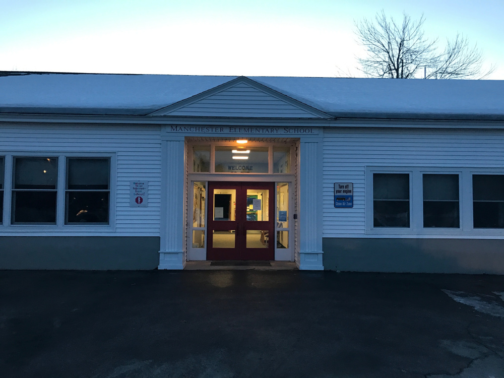Some parents of pupils at Manchester Elementary School, shown here Wednesday evening, are complaining that the school district failed to communicate with them appropriately about the discovery of mold in the school's basement and some of its classrooms.