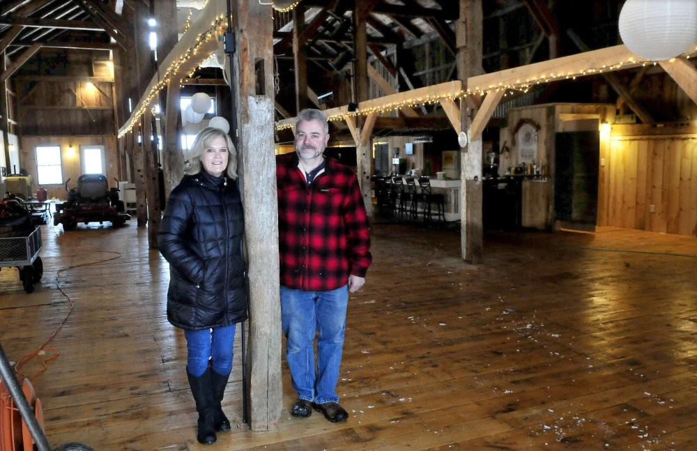 Cathy and Parris Varney stand on Thursday inside their renovated barn, which they would like to turn into an event center at their home in China.