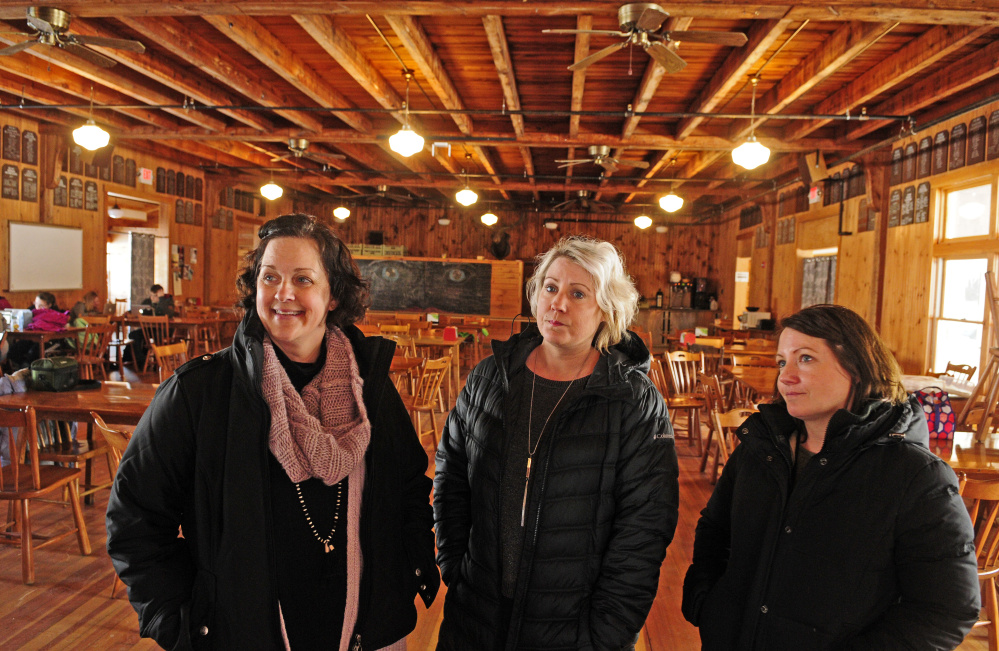 Christa Johnson, director of development at Snow Pond Center for the Arts, left, and Maggi Milligan and Mandy Milligan, from The Lakeside Lodge, talk about petitioning to change liquor rules during an interview Thursday in the lodge at Snow Pond Center for the Arts.