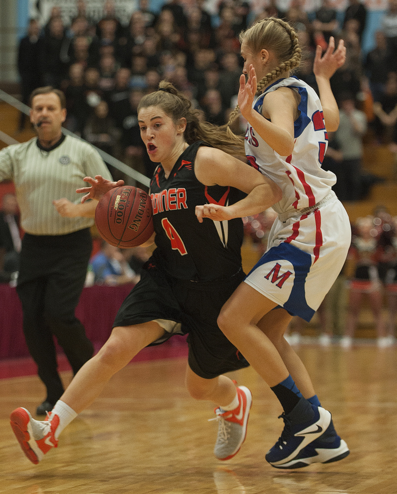 Gardiner's Lauren Chadwick brings the ball down the floor as Messalonskee's Ally Turner defends during a Class A North quarterfinal game Friday at the Augusta Civic Center.