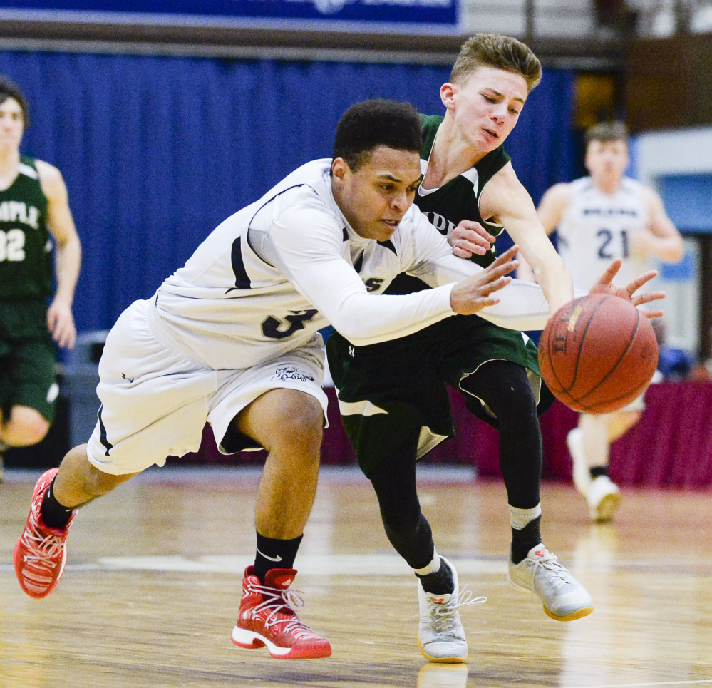 Temple's Micah Riportella fights to recover the ball after Gould's Tyrese Collins attempted a steal in the third quarter of a Class D South quarterfinal Saturday in Augusta. The Bereans fell to the Bears 76-63.