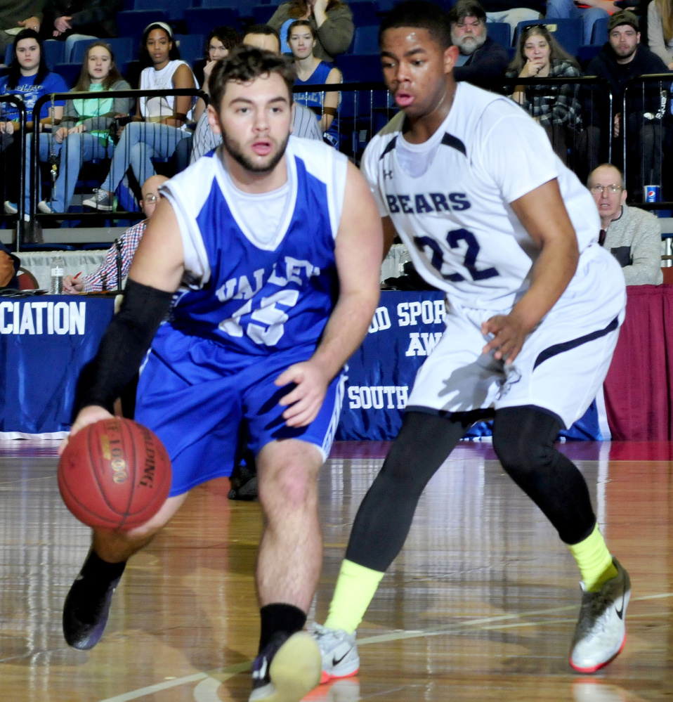 Valley's Brandon Thomas dribbles past A.R. Gould's Issak Aliyow during a Class D South semifinal Wednesday at the Augusta Civic Center.