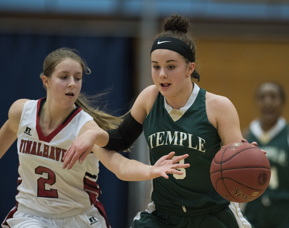 Temple's Veronica Rossignol beings the ball up the court as Vinalhaven's Ashlyn Littlefield applies pressure during a Class D South semifinal Thursday morning at the Augusta Civic Center.