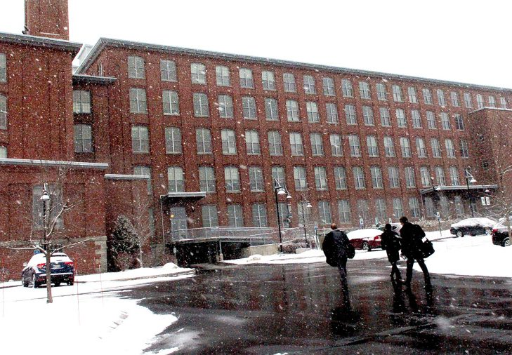 People enter the Hathaway Creative Center in Waterville on Dec. 5. The building has been sold for $20 million.