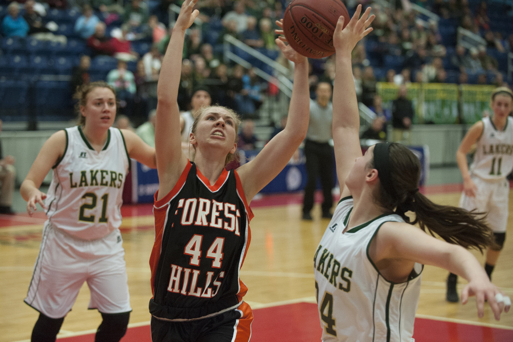 Forest Hills' Caitlin Logston and Rangely's Sydney Royce fight for a rebound during a Class D South semifinal at the Augusta Civic Center in Augusta on Thursday.