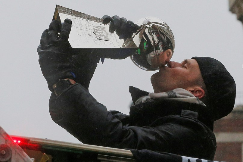 New England Patriots quarterback Tom Brady, who led the team to the greatest comeback victory in Super Bowl history, plants a kiss on the Lombardi Trophy during the team's Feb. 9 victory parade in Boston.