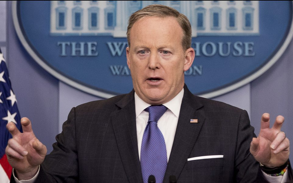 "Press secretary Sean Spicer speaks during the daily press briefing at the White House on Monday. Spicer tried to clarify President Trump's comments, saying, ""The president used the word wiretap in quotes to mean broadly surveillance and other activities."""