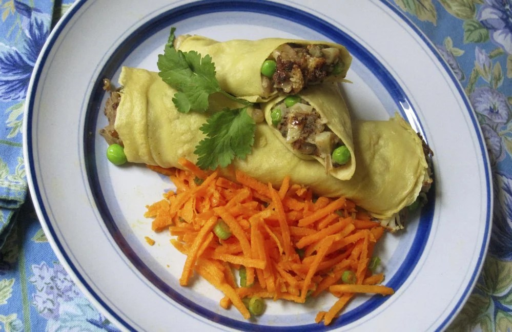 Chickpea crepes stuffed with Indian spiced potatoes and peas.