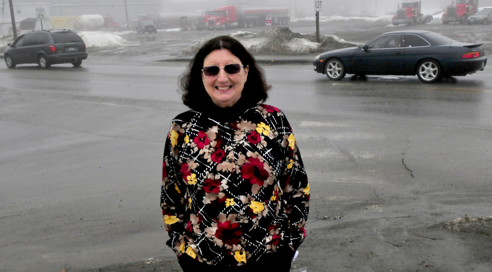 Regional School Unit 18 school health coordinator and grant writer Claire Heffernan stands Wednesday at the intersection of busy Heath and Oak streets in Oakland, where new sidewalks, a crosswalk and lights will be installed for student safety.