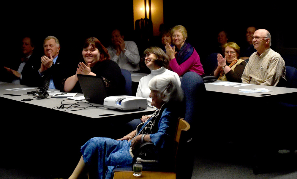People applaud Hope Wing Weston on Wednesday as she is introduced during a presentation about her father, Eugene Wing, by the Fairfield Historical Society at the Lawrence Junior High School library in Fairfield.