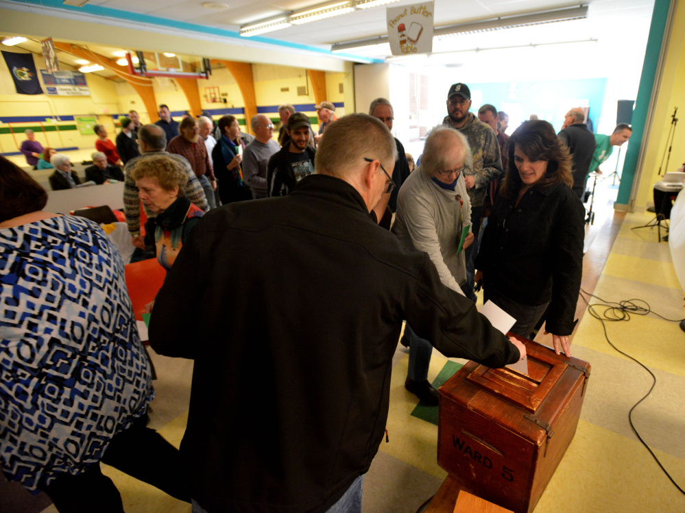Sidney residents deposit their secret ballots for Budget Committee members Saturday during Town Meeting at James H. Bean School.