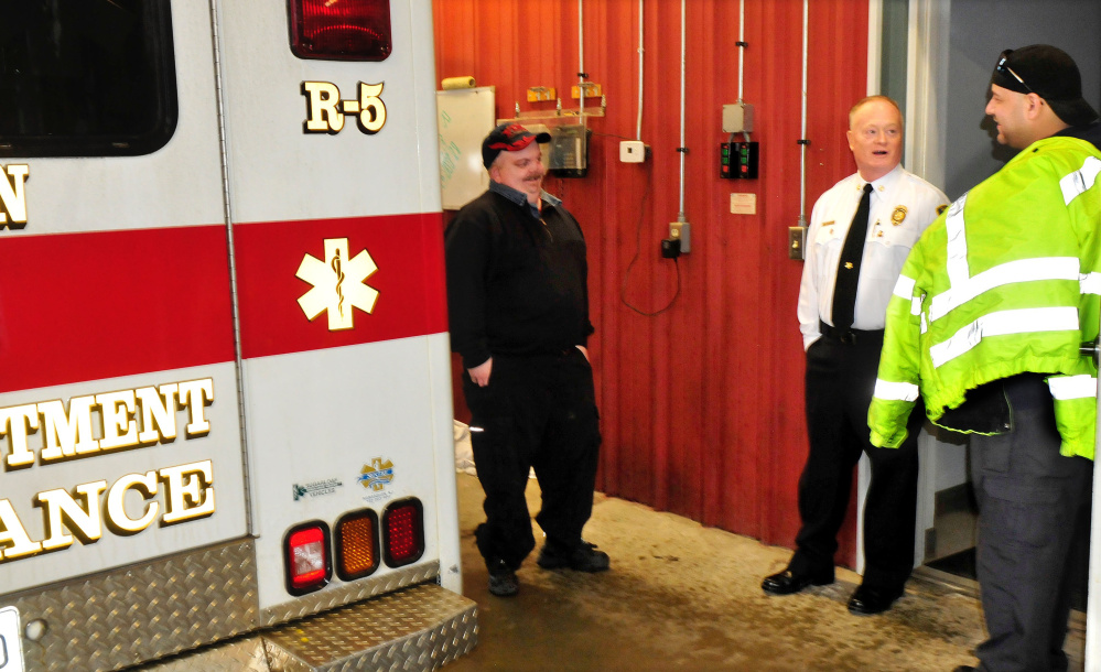 Clinton Fire Chief Gary Petley, center, is retiring from a career as a firefighter, having been chief of his department for 25 years. Petley spoke Wednesday with Travis Cousins, left, and Travis Fillmore in the rescue bay area in the fire station.
