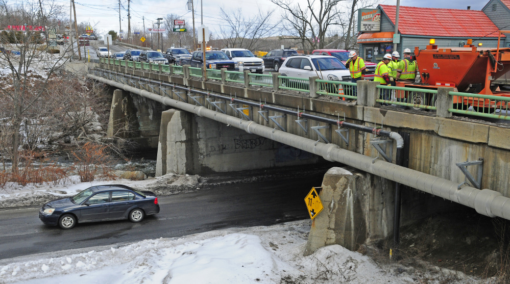 The Bridge Street bridge over Cobbosseecontee Stream in Gardiner, with Dennis' Pizza in the background, is seen Jan. 27. The pizza shop is expected to move permanently before major work is done to the bridge in 2019.
