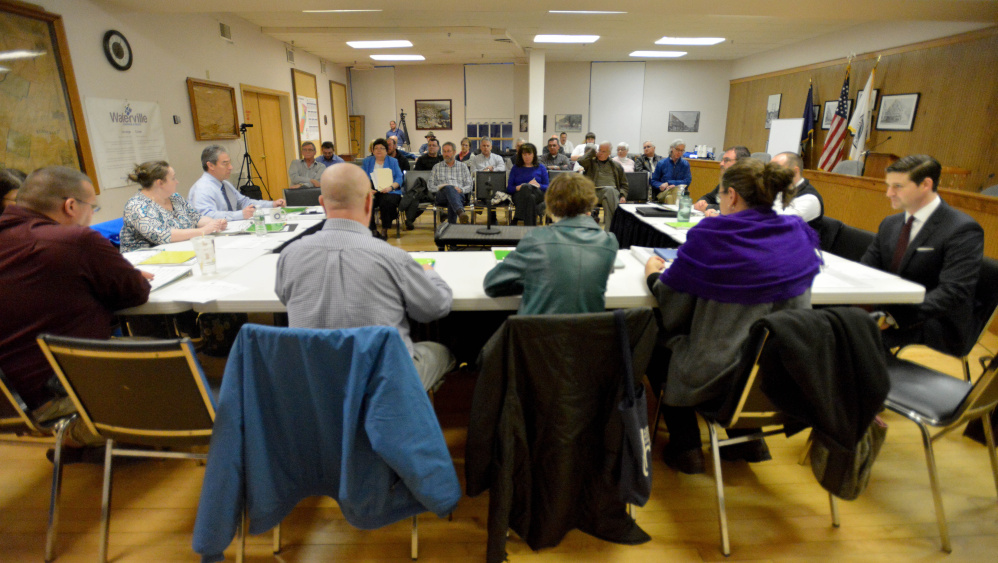 City council members open the budget meeting at the City Chambers in Waterville on Tuesday.