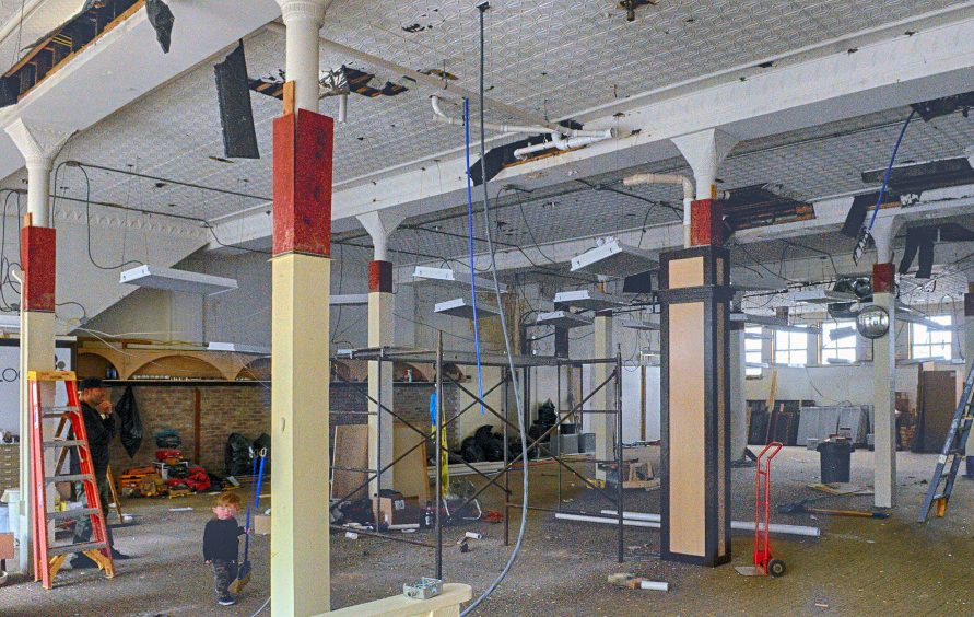 This April 23, 2016, view shows the interior of the former Stacy's Hallmark on Water Street in downtown Augusta, which developers plan to renovate into space for a brew pub.
