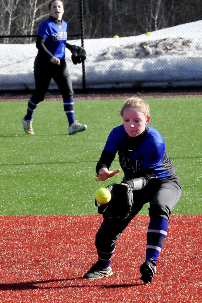 Colby's Robin Spofford catches a line drive against Thomas on Thursday in Waterville.