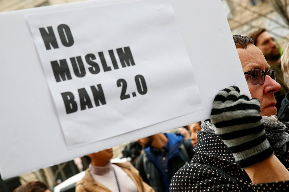 Immigration activists rally on March 7 against the Trump administration's revised ban against travelers from six Muslim-majority nations, outside of the U.S. Customs and Border Protection headquarters in Washington.