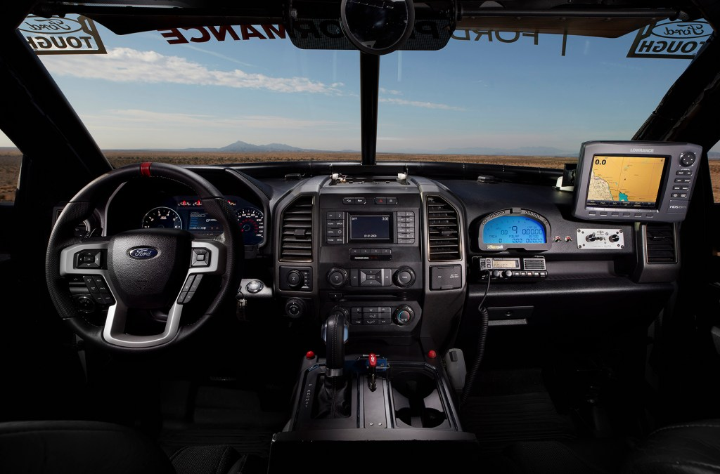 The interior of the Ford F-150 Raptor race truck features a custom-fabricated roll cage, MasterCraft seats with five-point harness safety belts, Lowrance GPS, RacePak digital dash and a data logger to track vehicle performance.