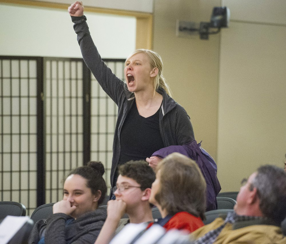 Bethany Edmunds of Biddeford makes her voice heard at the forum. Protesters, who were seated throughout the crowd, stood up at random intervals to interrupt the governor and shout at him before exiting.