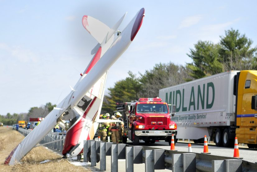 Traffic continues to flow in one lane on Tuesday past the scene of a plane crash in the southbound breakdown lane of Interstate 295 in Bowdoinham.