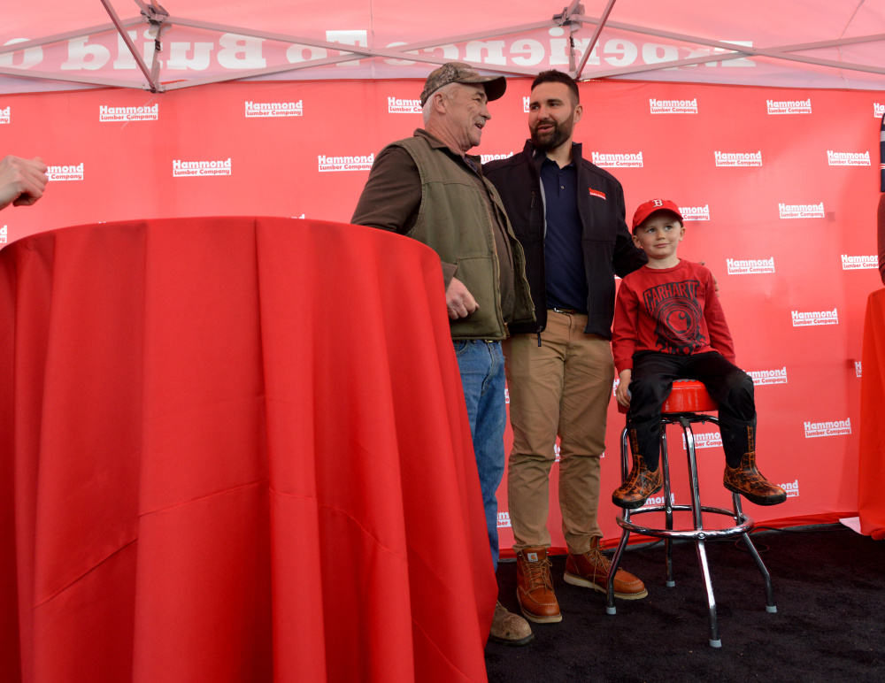 Rob Ninkovich, of the New England Patriots, stands with fans for a photograph Wednesday at Hammond Lumber Co. in Belgrade during a meet and greet.