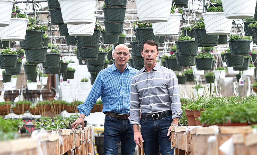 Michael Roy, left, and Brent Burger, of Campbell's True Value, pose for a portrait in one of the greenhouses at Campbell's Agway True Value hardware store in Winslow.
