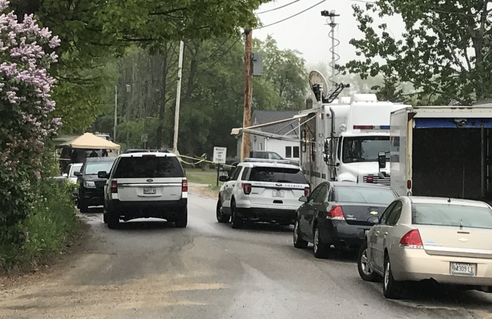 Police vehicles line the road Monday near the home in Arundel where a man was fatally shot by sheriff's deputies responding to a report of a domestic dispute.